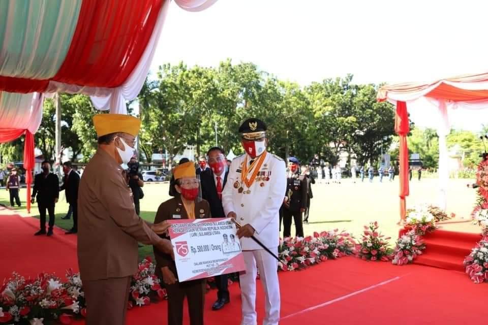 Gubernur Sulut Olly Dondokambey menyerahkan bantuan bagi LVRI, yang diserahkan secara simbolis.(Foto: ist)